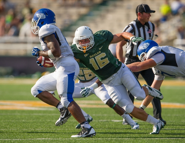 Sep 7, 2013; Waco, TX, USA; Baylor Bears linebacker Kendall Ehrlich (16) chases Buffalo Bulls running back Anthone Taylor (14) during the game at Floyd Casey Stadium. The Bears defeated the Bulls 70-13. Mandatory Credit: Jerome Miron-USA TODAY Sports