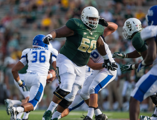 Sep 7, 2013; Waco, TX, USA; Baylor Bears offensive linesman LaQuan McGowan (60) during the game against the Buffalo Bulls at Floyd Casey Stadium. The Bears defeated the Bulls 70-13. Mandatory Credit: Jerome Miron-USA TODAY Sports