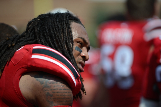 Sep 7, 2013; Louisville, KY, USA; Louisville Cardinals safety Calvin Pryor (25) looks on from the sideline during the second half against Eastern Kentucky Colonels at Papa John's Cardinal Stadium. Louisville defeated Eastern Kentucky 44-7.  Mandatory Credit: Jamie Rhodes-USA TODAY Sports