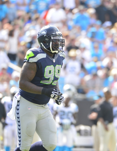Sep 8, 2013; Charlotte, NC, USA; Seattle Seahawks defensive tackle Tony McDaniel (99) on the field in the fourth quarter. The Seahawks defeated the Panthers 12-7 at Bank of America Stadium. Mandatory Credit: Bob Donnan-USA TODAY Sports