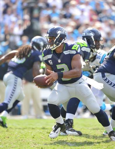 Sep 8, 2013; Charlotte, NC, USA; Seattle Seahawks quarterback Russell Wilson (3) with the ball in the fourth quarter. The Seahawks defeated the Panthers 12-7 at Bank of America Stadium. Mandatory Credit: Bob Donnan-USA TODAY Sports