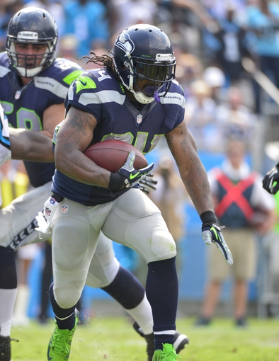 Sep 8, 2013; Charlotte, NC, USA; Seattle Seahawks running back Marshawn Lynch (24) runs in the fourth quarter. The Seahawks defeated the Panthers 12-7 at Bank of America Stadium. Mandatory Credit: Bob Donnan-USA TODAY Sports
