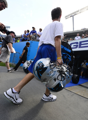 Sep 8, 2013; Charlotte, NC, USA; Carolina Panthers staff carry in helmets after the game. The Seahawks defeated the Panthers 12-7 at Bank of America Stadium. Mandatory Credit: Bob Donnan-USA TODAY Sports
