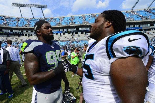 Sep 8, 2013; Charlotte, NC, USA; Seattle Seahawks defensive tackle Tony McDaniel (99) shakes hands with Carolina Panthers offensive tackle Chris Scott (75) after the game. The Seahawks defeated the Panthers 12-7 at Bank of America Stadium. Mandatory Credit: Bob Donnan-USA TODAY Sports