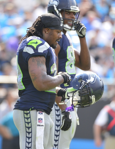 Sep 8, 2013; Charlotte, NC, USA; Seattle Seahawks running back Marshawn Lynch (24) on the field in the fourth quarter. The Seahawks defeated the Panthers 12-7 at Bank of America Stadium. Mandatory Credit: Bob Donnan-USA TODAY Sports