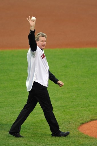 Sep 9, 2013; Cleveland, OH, USA; Former pitcher Orel Hershiser waves before throwing out the ceremonial first pitch prior to a game between the Cleveland Indians and the Kansas City Royals at Progressive Field. Mandatory Credit: David Richard-USA TODAY Sports
