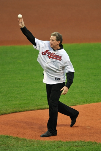 Sep 9, 2013; Cleveland, OH, USA; Former pitcher Orel Hershiser throws the ceremonial first pitch prior to a game between the Cleveland Indians and the Kansas City Royals at Progressive Field. Mandatory Credit: David Richard-USA TODAY Sports