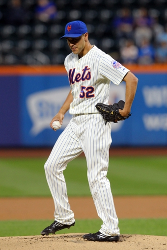 Sep 9, 2013; New York, NY, USA; New York Mets starting pitcher Carlos Torres (52) reacts after allowing back-to-back home runs against the Washington Nationals during the first inning of a game at Citi Field. Mandatory Credit: Brad Penner-USA TODAY Sports