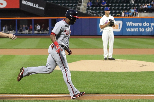 Sep 9, 2013; New York, NY, USA; Washington Nationals center fielder Denard Span (2) rounds the bases in front of New York Mets starting pitcher Carlos Torres (52) after hitting a solo home run against the New York Mets during the first inning of a game at Citi Field. Mandatory Credit: Brad Penner-USA TODAY Sports