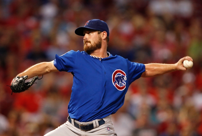 Sep 9, 2013; Cincinnati, OH, USA; Chicago Cubs starting pitcher Travis Wood (37) pitches during the third inning against the Cincinnati Reds at Great American Ball Park. Mandatory Credit: Frank Victores-USA TODAY Sports