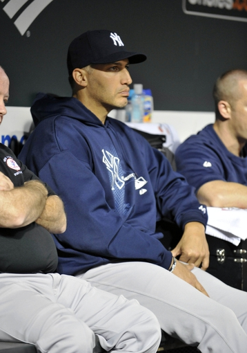 Sep 9, 2013; Baltimore, MD, USA; New York Yankees pitcher Andy Pettitte (46) in the dugout during the second inning against the Baltimore Orioles at Oriole Park at Camden Yards. Mandatory Credit: Joy R. Absalon-USA TODAY Sports