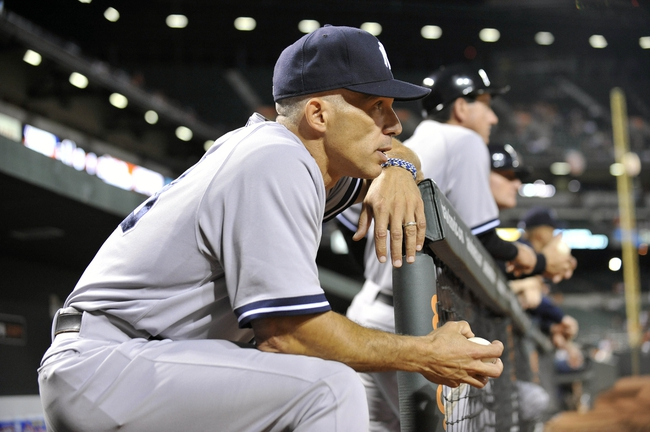 Sep 9, 2013; Baltimore, MD, USA; New York Yankees manager Joe Girardi (28) in the dugout during the third inning against the Baltimore Orioles at Oriole Park at Camden Yards. Mandatory Credit: Joy R. Absalon-USA TODAY Sports