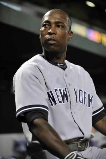 Sep 9, 2013; Baltimore, MD, USA; New York Yankees left fielder Alfonso Soriano (12) in the dugout during the second inning against the Baltimore Orioles at Oriole Park at Camden Yards. Mandatory Credit: Joy R. Absalon-USA TODAY Sports