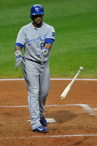 Sep 9, 2013; Cleveland, OH, USA; Kansas City Royals second baseman Emilio Bonifacio (64) throws his bat after striking out in the third inning against the Cleveland Indians at Progressive Field. Mandatory Credit: David Richard-USA TODAY Sports