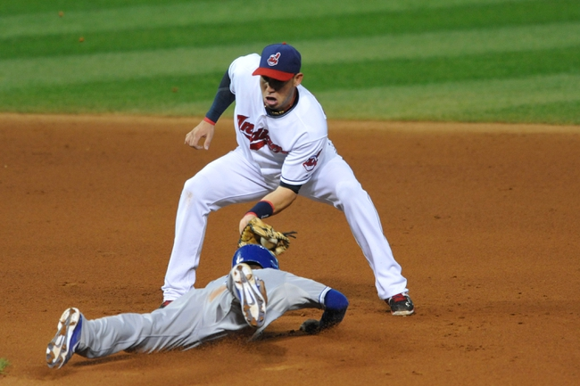 Sep 9, 2013; Cleveland, OH, USA; Cleveland Indians shortstop Asdrubal Cabrera (13) tags out Kansas City Royals center fielder Jarrod Dyson (1) on an attempted steal of second base in the fifth inning at Progressive Field. Mandatory Credit: David Richard-USA TODAY Sports