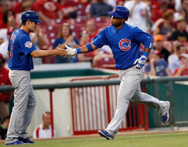 Sep 9, 2013; Cincinnati, OH, USA; Chicago Cubs third baseman Luis Valbuena (24) is congratulated by third base coach David Bell (3) after hitting a home run during the third inning against the Cincinnati Reds at Great American Ball Park. Mandatory Credit: Frank Victores-USA TODAY Sports