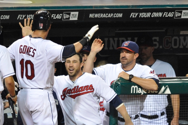 Sep 9, 2013; Cleveland, OH, USA; Cleveland Indians catcher Yan Gomes (10) celebrates his solo home run with second baseman Jason Kipnis (center) and pitching coach Mickey Callaway (44) in the fifth inning against the Kansas City Royals at Progressive Field. Mandatory Credit: David Richard-USA TODAY Sports
