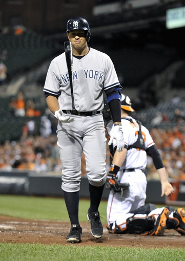 Sep 9, 2013; Baltimore, MD, USA; New York Yankees third baseman Alex Rodriguez (13) reacts after striking out in the third inning against the Baltimore Orioles at Oriole Park at Camden Yards. Mandatory Credit: Joy R. Absalon-USA TODAY Sports