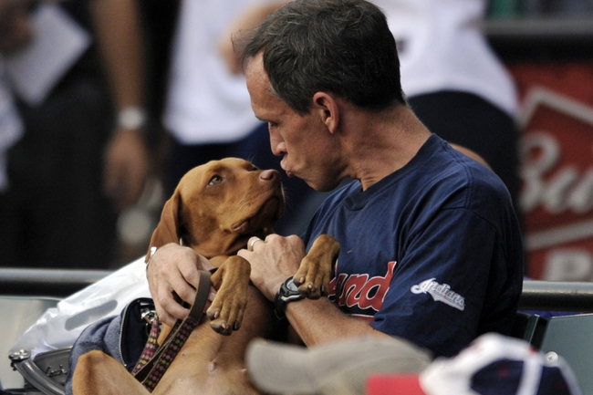 Sep 9, 2013; Cleveland, OH, USA; A fan sits in the stands with his dog on puppypalooza night during the game between the Kansas City Royals and the Cleveland Indians at Progressive Field. Mandatory Credit: David Richard-USA TODAY Sports