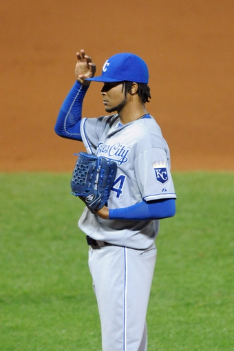 Sep 9, 2013; Cleveland, OH, USA; Kansas City Royals starting pitcher Ervin Santana (54) reacts after giving up a home run in the seventh inning against the Cleveland Indians at Progressive Field. Mandatory Credit: David Richard-USA TODAY Sports