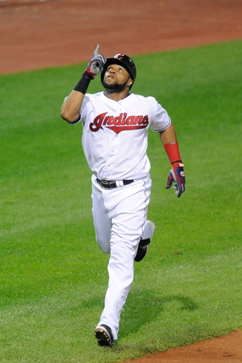 Sep 9, 2013; Cleveland, OH, USA; Cleveland Indians designated hitter Carlos Santana (41) celebrates his solo home run in the seventh inning against the Kansas City Royals at Progressive Field. Mandatory Credit: David Richard-USA TODAY Sports
