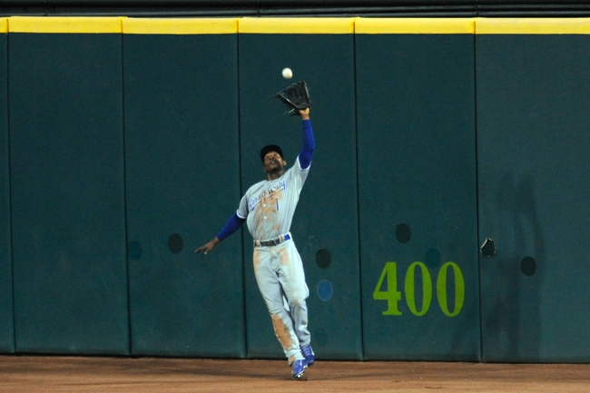 Sep 9, 2013; Cleveland, OH, USA; Kansas City Royals center fielder Jarrod Dyson (1) makes a catch on the warning track in the seventh inning against the Cleveland Indians at Progressive Field. Mandatory Credit: David Richard-USA TODAY Sports