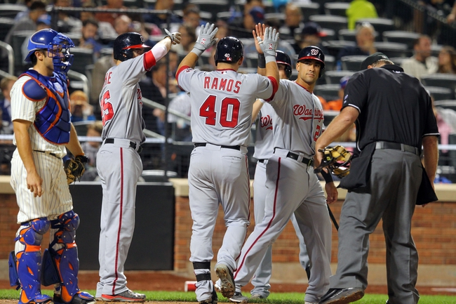Sep 9, 2013; New York, NY, USA; Washington Nationals catcher Wilson Ramos (40) is congratulated by Washington Nationals first baseman Adam LaRoche (25) and Washington Nationals shortstop Ian Desmond (20) after hitting a three-run home run against the New York Mets during the fifth inning of a game at Citi Field. Mandatory Credit: Brad Penner-USA TODAY Sports