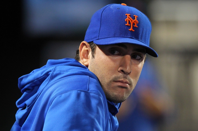 Sep 9, 2013; New York, NY, USA; New York Mets injured starting pitcher Matt Harvey (33) looks on from the dugout during the sixth inning of a game against the Washington Nationals at Citi Field. Mandatory Credit: Brad Penner-USA TODAY Sports