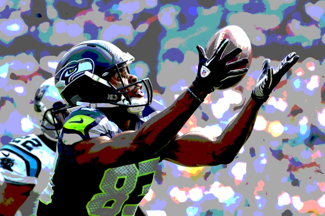 Sep 8, 2013; Charlotte, NC, USA; Seattle Seahawks wide receiver Stephen Williams (83) tries to make a catch as Carolina Panthers cornerback Josh Thomas (22) defends in the fourth quarter. The Seahawks defeated the Panthers 12-7 at Bank of America Stadium. Editors note; This images was manipulated with photoshop filters. Mandatory Credit: Bob Donnan-USA TODAY Sports