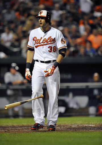 Sep 9, 2013; Baltimore, MD, USA; Baltimore Orioles left fielder Michael Morse (38) reacts after striking out in the sixth inning against the New York Yankees at Oriole Park at Camden Yards. The Orioles defeated the Yankees 4-2. Mandatory Credit: Joy R. Absalon-USA TODAY Sports