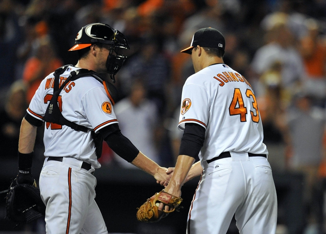 Sep 9, 2013; Baltimore, MD, USA; Baltimore Orioles catcher Matt Wieters (32) congratulates closer Jim Johnson (43) after a game against the New York Yankees at Oriole Park at Camden Yards. The Orioles defeated the Yankees 4-2. Mandatory Credit: Joy R. Absalon-USA TODAY Sports