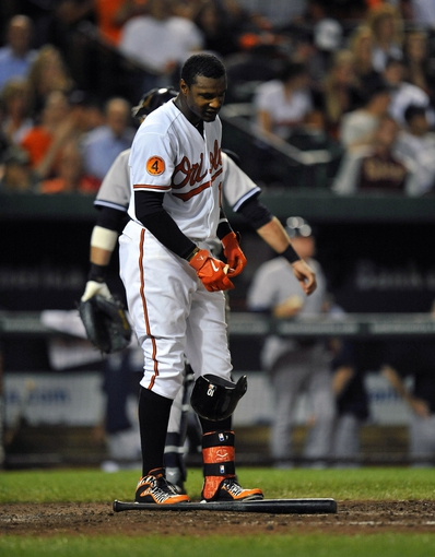 Sep 9, 2013; Baltimore, MD, USA; Baltimore Orioles center fielder Adam Jones (10) reacts after striking out in the seventh inning against the New York Yankees at Oriole Park at Camden Yards. The Orioles defeated the Yankees 4-2. Mandatory Credit: Joy R. Absalon-USA TODAY Sports