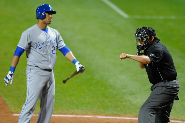 Sep 9, 2013; Cleveland, OH, USA; Home plate umpire Doug Eddings (88) calls strike three on Kansas City Royals pinch hitter Carlos Pena (23) in the ninth inning against the Cleveland Indiansat Progressive Field. Mandatory Credit: David Richard-USA TODAY Sports
