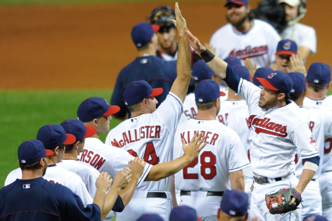 Sep 9, 2013; Cleveland, OH, USA; Cleveland Indians second baseman Jason Kipnis (right) celebrates a 4-3 win over the Kansas City Royals at Progressive Field. Mandatory Credit: David Richard-USA TODAY Sports