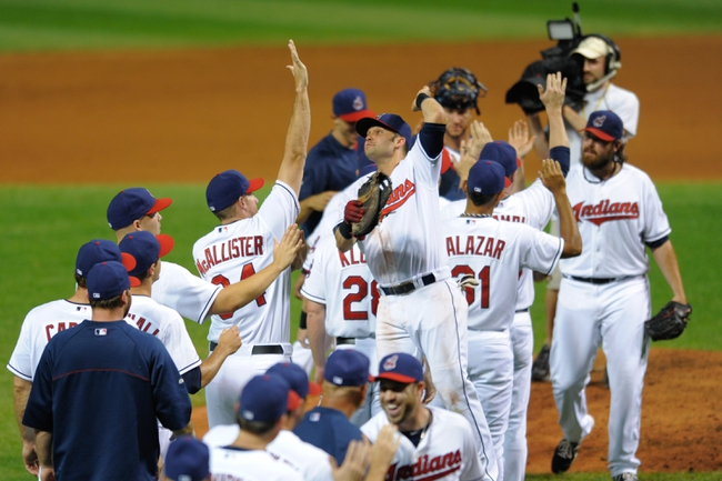 Sep 9, 2013; Cleveland, OH, USA; First baseman Nick Swisher (center) and the Cleveland Indians celebrate a 4-3 win over the Kansas City Royals at Progressive Field. Mandatory Credit: David Richard-USA TODAY Sports