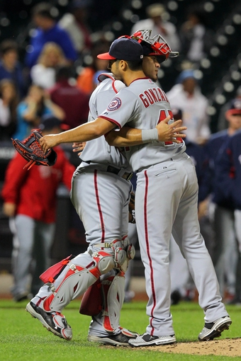 Sep 9, 2013; New York, NY, USA; Washington Nationals starting pitcher Gio Gonzalez (47) is congratulated by catcher Wilson Ramos (40) after recording the final out against the New York Mets during the ninth inning of a game at Citi Field. Gonzalez pitched a complete game one hitter in the 9-0 win. Mandatory Credit: Brad Penner-USA TODAY Sports
