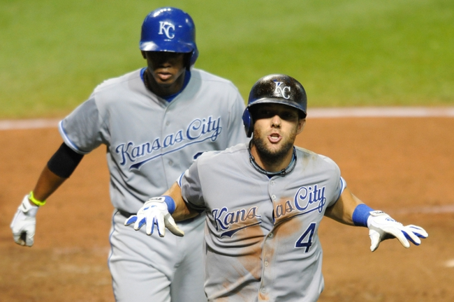 Sep 9, 2013; Cleveland, OH, USA; Kansas City Royals left fielder Alex Gordon (4) celebrates his two-run home run in the eighth inning against the Cleveland Indians at Progressive Field. Mandatory Credit: David Richard-USA TODAY Sports