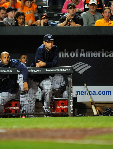 Sep 9, 2013; Baltimore, MD, USA; New York Yankees injured shortstop Derek Jeter (2) watches the action from the dugout during the seventh inning against the Baltimore Orioles at Oriole Park at Camden Yards. The Orioles defeated the Yankees 4-2. Mandatory Credit: Joy R. Absalon-USA TODAY Sports