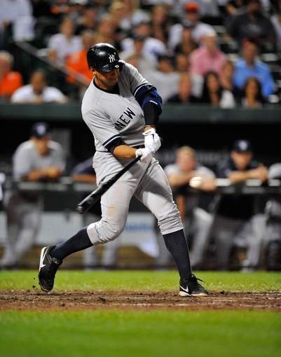 Sep 9, 2013; Baltimore, MD, USA; New York Yankees third baseman Alex Rodriguez (13) singles in the ninth inning against the Baltimore Orioles at Oriole Park at Camden Yards. The Orioles defeated the Yankees 4-2. Mandatory Credit: Joy R. Absalon-USA TODAY Sports