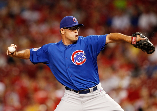 Sep 9, 2013; Cincinnati, OH, USA; Chicago Cubs relief pitcher Kevin Gregg (63) pitches during the ninth inning against the Cincinnati Reds at Great American Ball Park. The Cubs defeated the Reds 2-0. Mandatory Credit: Frank Victores-USA TODAY Sports