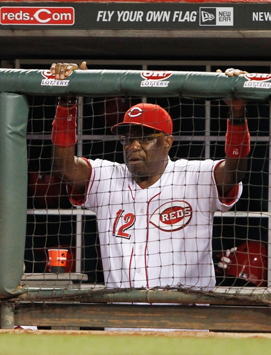 Sep 9, 2013; Cincinnati, OH, USA; Cincinnati Reds manager Dusty Baker (12) in the dug out during the ninth inning against the Chicago Cubs at Great American Ball Park. The Cubs defeated the Reds 2-0. Mandatory Credit: Frank Victores-USA TODAY Sports