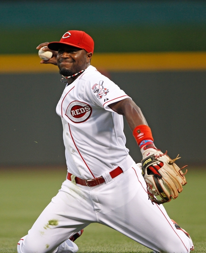 Sep 9, 2013; Cincinnati, OH, USA; Cincinnati Reds second baseman Brandon Phillips (4) makes a play during the third inning against the Chicago Cubs at Great American Ball Park. Mandatory Credit: Frank Victores-USA TODAY Sports