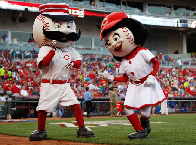 Sep 9, 2013; Cincinnati, OH, USA; Cincinnati Reds mascots Mr Redlegs and Rosie dance prior to the game against the Chicago Cubs at Great American Ball Park. Mandatory Credit: Frank Victores-USA TODAY Sports