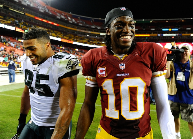 Sep 9, 2013; Landover, MD, USA; Washington Redskins quarterback Robert Griffin III (10) talks with Philadelphia Eagles linebacker Mychal Kendricks (95) after the game at FedEX Field. The Eagles won 33 - 27. Mandatory Credit: Brad Mills-USA TODAY Sports