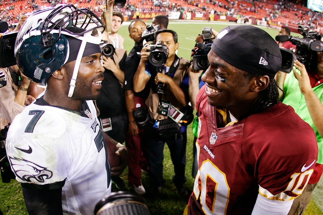 Sep 9, 2013; Landover, MD, USA; Philadelphia Eagles quarterback Michael Vick (7) and Washington Redskins quarterback Robert Griffin III (10) talk on the field after their game at FedEx Field. The Philadelphia Eagles won 33-27. Mandatory Credit: Geoff Burke-USA TODAY Sports
