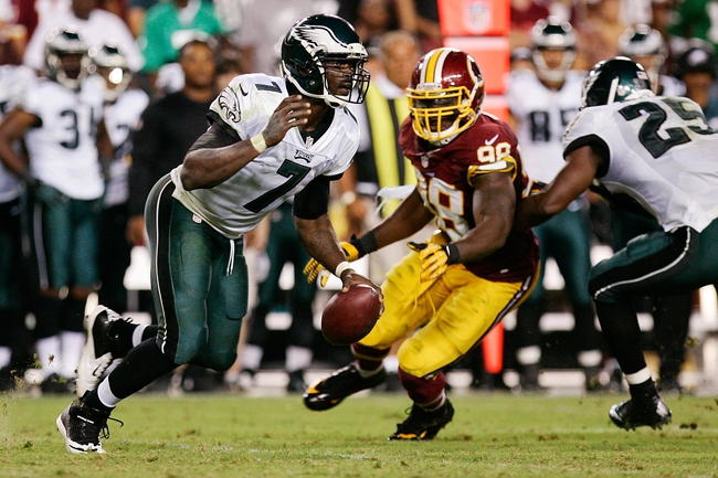 Sep 9, 2013; Landover, MD, USA; Philadelphia Eagles quarterback Michael Vick (7) runs with the ball as Washington Redskins outside linebacker Brian Orakpo (98) chases in the fourth quarter at FedEx Field. The Eagles won 33-27. Mandatory Credit: Geoff Burke-USA TODAY Sports