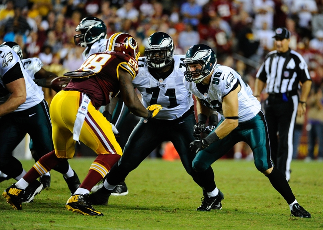 Sep 9, 2013; Landover, MD, USA; Philadelphia Eagles tight end Zach Ertz (86) prepares to block against Washington Redskins linebacker Brian Orakpo (98) during the second half at FedEX Field. The Eagles won 33 - 27. Mandatory Credit: Brad Mills-USA TODAY Sports