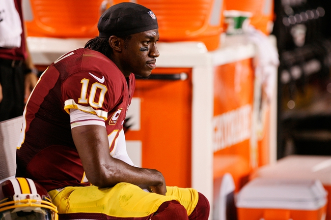 Sep 9, 2013; Landover, MD, USA; Washington Redskins quarterback Robert Griffin III (10) watches from the bench against the Philadelphia Eagles in the fourth quarter at FedEx Field. The Eagles won 33-27. Mandatory Credit: Geoff Burke-USA TODAY Sports
