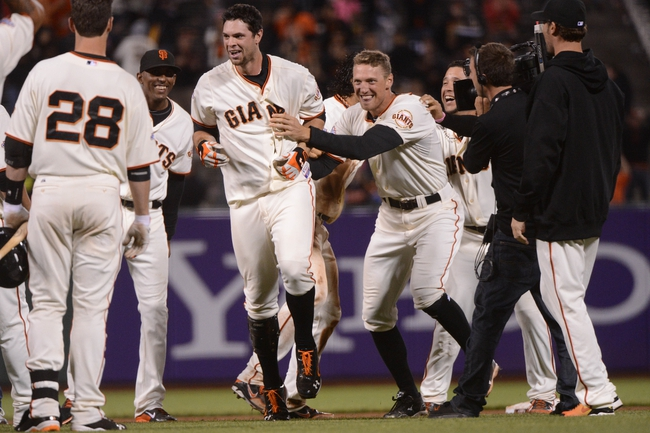 September 9, 2013; San Francisco, CA, USA; San Francisco Giants first baseman Brandon Belt (9, left) is congratulated by right fielder Hunter Pence (8, right) for hitting a RBI-single to score center fielder Angel Pagan (16, not pictured) against the Colorado Rockies during the 10th inning at AT&T Park. The Giants defeated the Rockies 3-2 in 10 innings. Mandatory Credit: Kyle Terada-USA TODAY Sports