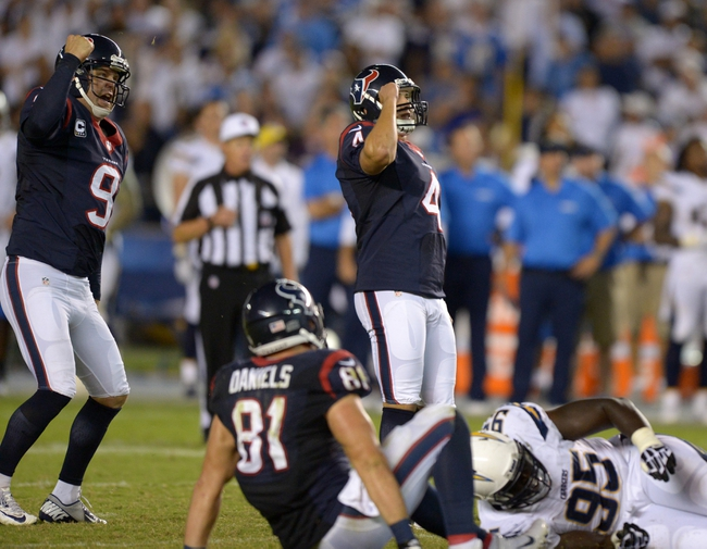 Sep 9, 2013; San Diego, CA, USA; Houston Texans kicker Randy Bullock (4) celebrates with Shane Lechler (9) after kicking a 41-yard field goal as time expires against the San Diego Chargers at Qualcomm Stadium. The Texans defeated the Chargers 31-28. Mandatory Credit: Kirby Lee-USA TODAY Sports